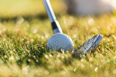 Close-up of golf ball with club Stock Photos