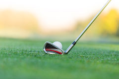 Close-up of golf ball with club Royalty Free Stock Photos