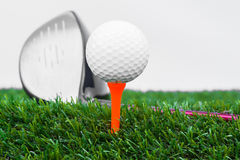 Close up of golf ball and driver Royalty Free Stock Photo
