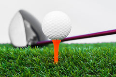 Close up of golf ball and driver Royalty Free Stock Images