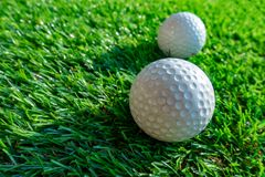 close up golf ball on grass royalty free stock images