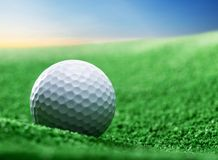 Close up of golf ball on green tee Royalty Free Stock Photography