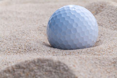 Close up golf ball in sand bunker. Close up golf ball in sand bunker shallow depth of field Royalty Free Stock Photo