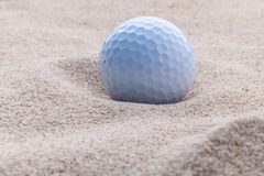 Close up golf ball in sand bunker. Close up golf ball in sand bunker shallow depth of field Stock Photos