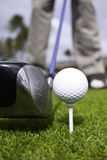 Close up of golf ball on tee and driver set up Stock Photos