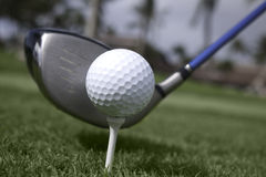 Close up of golf ball on tee and driver set up Royalty Free Stock Images