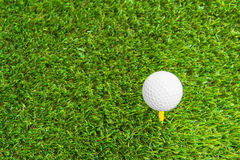 Close up of golf ball and tee Royalty Free Stock Photography