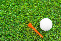 Close up of golf ball and tee Royalty Free Stock Photo