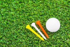 Close up of golf ball and tee Stock Photography