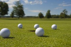 Close-up of golf balls on a golf course Stock Photos
