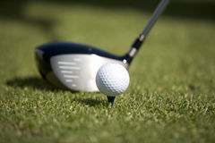 Close-up of a golf club and ball on a tee Royalty Free Stock Image