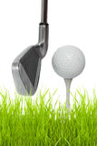 Close up of a golf club with ball and tee. Isolated against white background Royalty Free Stock Image
