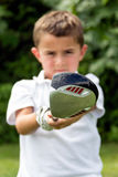 Close-up of golf driver club head held by little boy golfer - se Stock Image