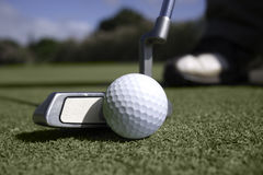 Close up of golfer putting on the green Royalty Free Stock Photos