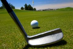 Close up of golfer teeing off Royalty Free Stock Photo