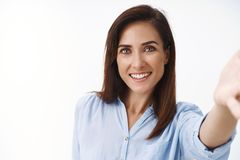 Free Close-up Good-looking Tender Friendly Pretty Middle-aged 30s Woman Extend Arm, Hold Camera In Hand And Smiling Broadly Royalty Free Stock Image - 163480196