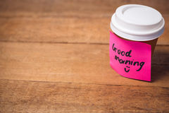 Close up of good morning text stuck on disposable cup. At wooden table Stock Photos