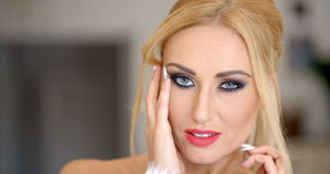 Close up Gorgeous Blond Woman Touching her Face stock video footage