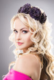 Close-up of gorgeous girl wearing a pink dress and a purple headband Royalty Free Stock Photography
