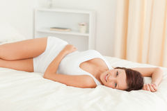 Close up of a gorgeous Woman relaxing on her bed Stock Images
