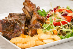 Close up Gourmet Main Dish with Grilled Pork Rib and Fried Potat Royalty Free Stock Images