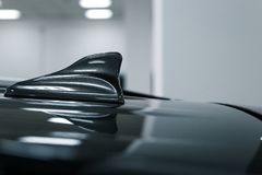 Close-up GPS antenna shark fin shape on a roof of car for radio navigation system stock image