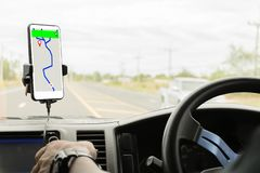 Close-up of gps navigation system In car. Close-up mobile smart phone inside a car, GPS navigation searching destination direction or address on gps map stock image