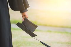 Close up Graduate holding a hat. Concept sucess education in University with copy space. Education graduation in university theme stock photography