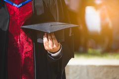 Close up Graduate holding a hat. Concept sucess education in University with copy space. Education graduation in university theme stock photos