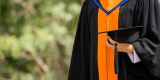 Close up Graduate holding a hat. Concept sucess education in University with copy space. Education graduation in university theme stock image