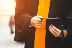 Close up Graduate holding a hat. Concept sucess education in University with copy space. Education graduation in university theme royalty free stock photos