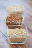 Close up of grain in glass bowls on wooden table Royalty Free Stock Photography