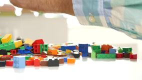Close Up With Grandpa Hands Playing with Plastic Bricks Construction Kids Game.  stock video footage
