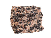 Close-up of granite an intrusive igneous rock. Natural sample of fine-grained granite, an intrusive igneous rock, isolated on white background royalty free stock photography