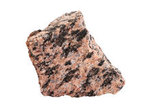 Close-up of granite an intrusive igneous rock. Natural sample of fine-grained granite, an intrusive igneous rock, isolated on white background stock images