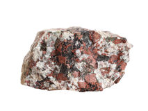 Close-up of granite, an intrusive igneous rock. Natural sample of granite, an intrusive igneous rock, isolated on white background stock photos