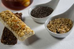 Granola bar and cereals on white background Royalty Free Stock Images