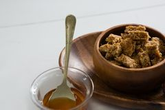Granola bar and honey on white background Royalty Free Stock Photos