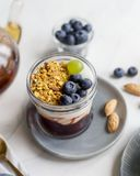 Close up granola with jam, cream and berries in jar stock photo