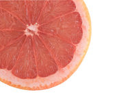 Close up of grapefruit section. Isolated on white background Royalty Free Stock Images