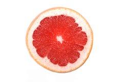 Close up of grapefruit slice on white background Stock Photo
