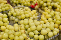 Close up of grapes on market stand Royalty Free Stock Image