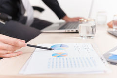 Close-up graph and charts on table during business meeting Royalty Free Stock Photos