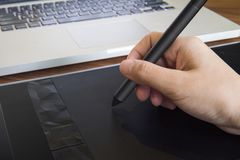 Close up of graphic designer hand using a pen on tablet with not royalty free stock images