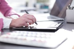 Close up. a graphic designer uses a graphics tablet sitting at D. Esk in Studio stock photo