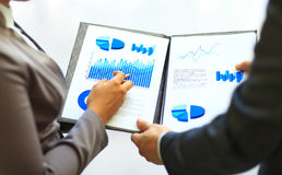 Close-up of graphs and charts analyzed Stock Images