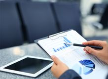 Close-up of graphs. And charts analyzed by businesswoman Royalty Free Stock Image