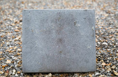 Close up of gravestone or memorial stone plate Royalty Free Stock Photo