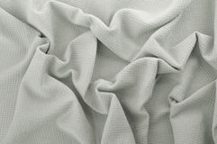 Close up of gray cotton fabric. Abstract background of crumpled tissue Royalty Free Stock Photos
