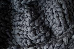 Close-up gray knitted blanket, merino wool background.  Royalty Free Stock Image